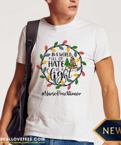 In A World Full Of Hate Be A Light Nurse Practitioner Christmas Shirt - Design By Reallovetees.com